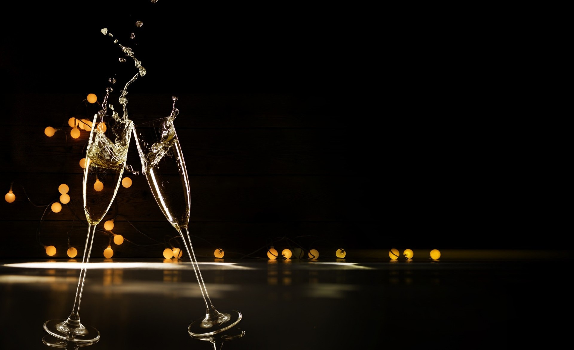 Champagne Glasses Infront Of Defocused Lights